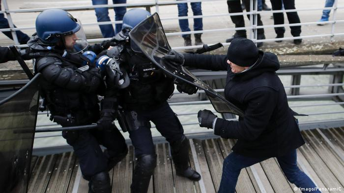 Protester Christopher D. punches police officers in Paris during yellow vest protest