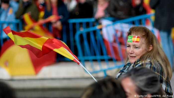 A woman waves a flag at a demonstration (Getty Images/AFP/O. del Pozo)