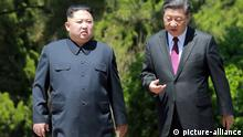Kim Jong Un, Xi Jinping (picture-alliance)