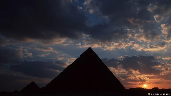 A silhouette of the pyramids of Giza