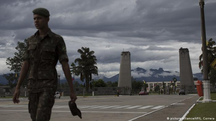 A Brazilian soldier walks by