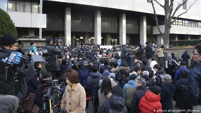 People gather to get admission tickets for the hearing of former Nissan Motor Co. Chairman Carlos Ghosn's request to disclose the grounds for detention