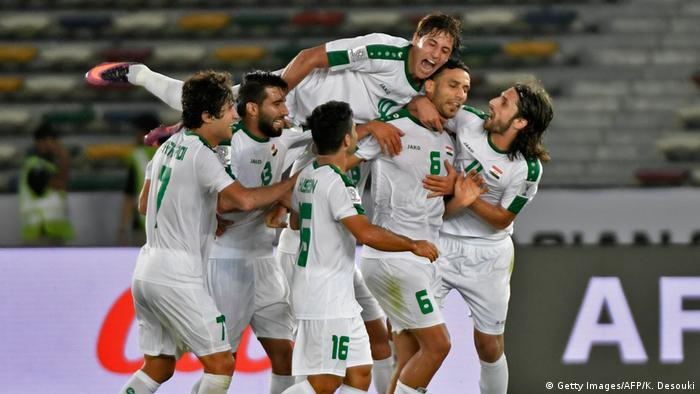 Ali Adnan and teammates celebrate as Iraq secure dramatic last-minute victory over Vietnam. (Getty Images/AFP/K. Desouki)