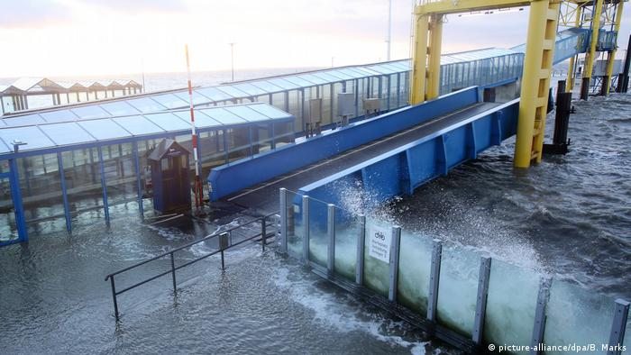 Ocean water surges at a ferry port