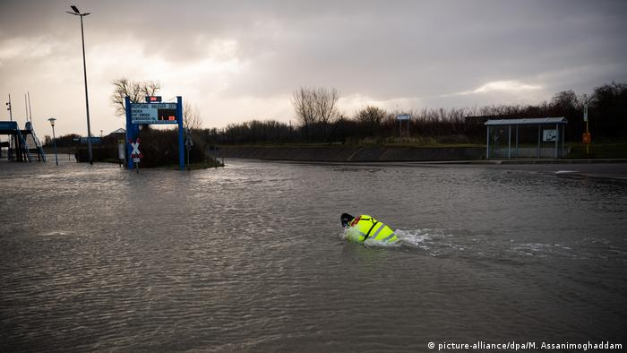 A ferry worker swims to the Borkum port