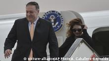 Secretary of State Mike Pompeo and his wife Susan disembark from their aircraft as they arrive in Amman, Jordan at the start of a Middle East tour, Tuesday, Jan. 8, 2018. (Andrew Caballero-Reynolds/Pool Photo via AP)  