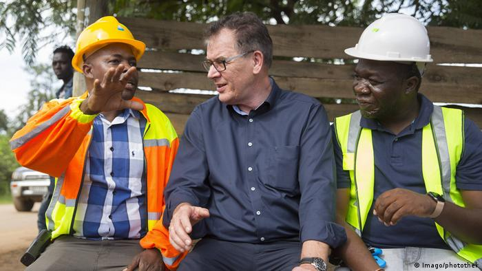 German Development Minister Gerd Müller talking to Zambian miners