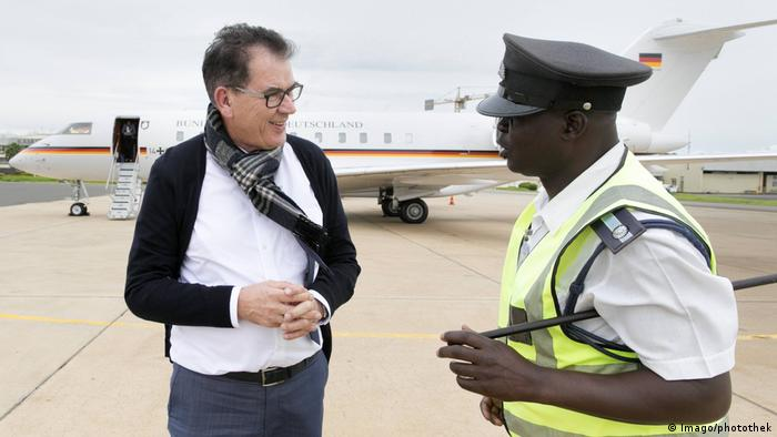 German Development Minister Gerd Mueller in front of his grounded plane in Malawi