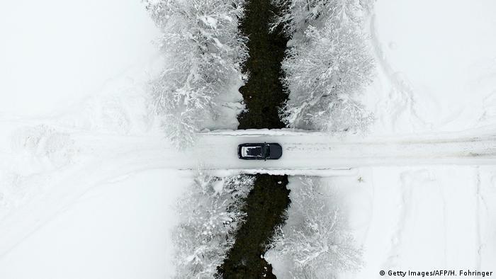 Crossing a snow-covered bridge in Austria