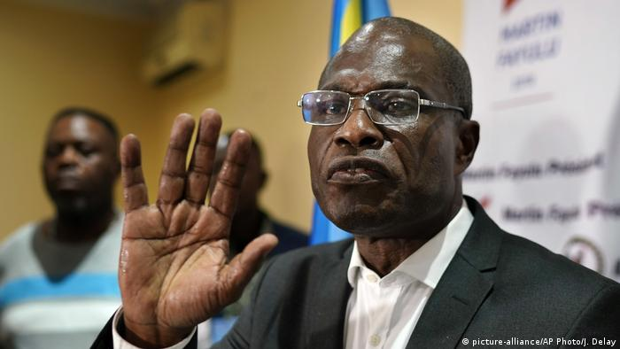 Martin Fayulu gestures with his hand during a press conference
