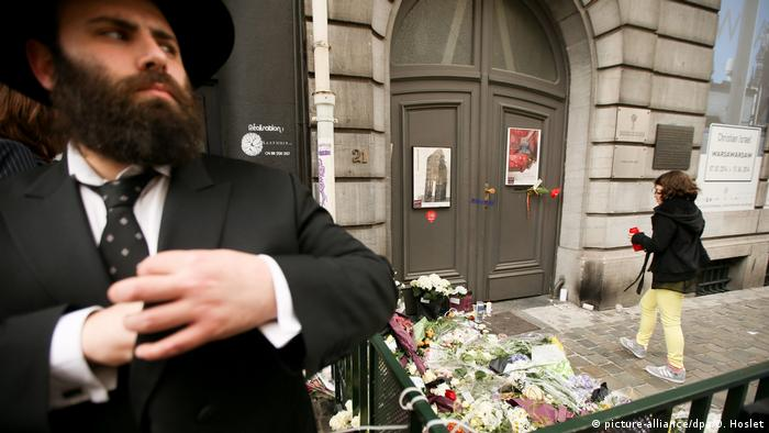 A man stands next to the entrance of the Jewish Museum in Brussels