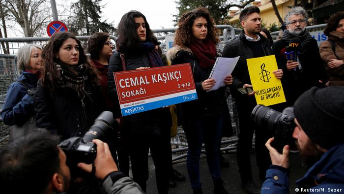 Amnesty International demonstrator hold up signs outside the barricaded Saudi Arabia Consulate in Istanbul to mark 100 day since the killing of journalist Jamal Khashoggi (Reuters/M. Sezer)