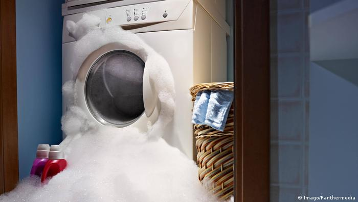 Washing machine overflowing with suds
