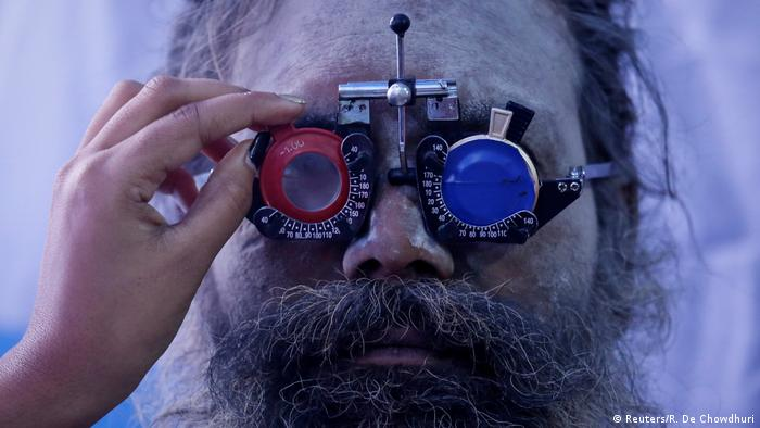 A Hindu holy man gets his eyes tested at a free eye-care camp