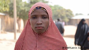 Rakiya Bala's husband is visiting her husband in the hospital. He was shot during a bandits' attack on their village.
