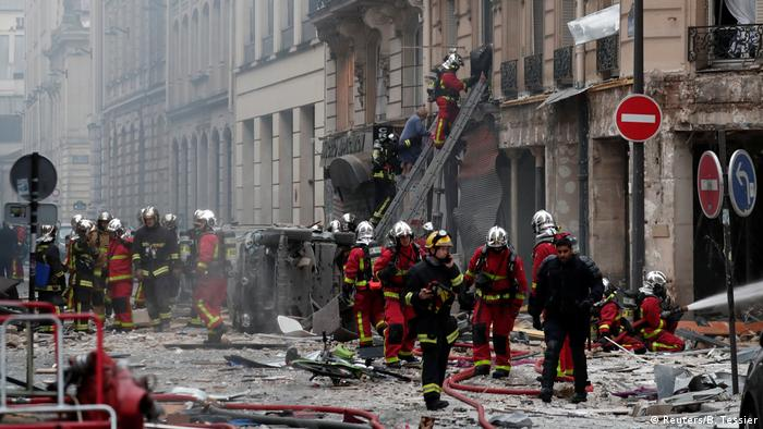 Firefighters attend to a fire after an explosion at a bakery in central Paris (Reuters/B. Tessier)