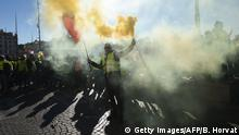 A Yellow Vest (Gilets jaunes) protester lights a flare during an anti-government demonstration called by the Yellow Vest movement in Marseille, southern France, on January 12, 2019. - France braced for a fresh round of yellow vest protests across the country on with the authorities vowing zero tolerance for violence after weekly scenes of rioting and vandalism in Paris and other cities over the past two months. (Photo by Boris HORVAT / AFP) (Photo credit should read BORIS HORVAT/AFP/Getty Images)