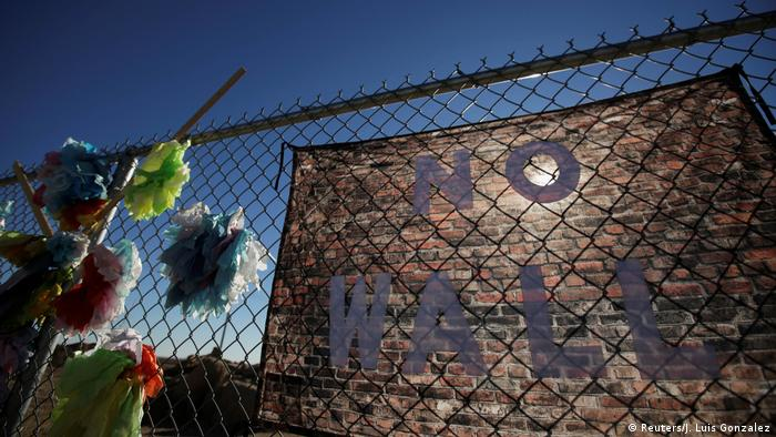 A banner placed by activists hangs from a fence near a tent city in Texas for migrant teens (Reuters/J. Luis Gonzalez)