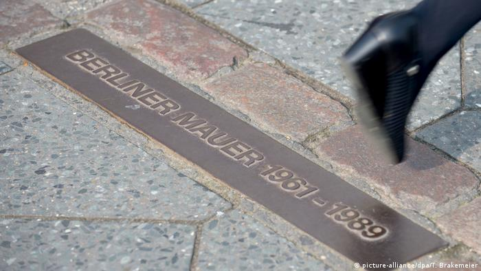 A plaque indicating where the Berlin Wall was