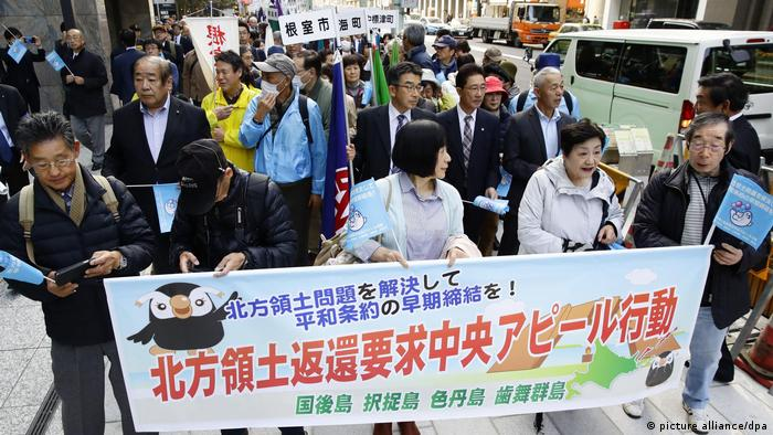 Japanese protesters calling for a settlement of the territorial dispute concerning the Kiril Islands