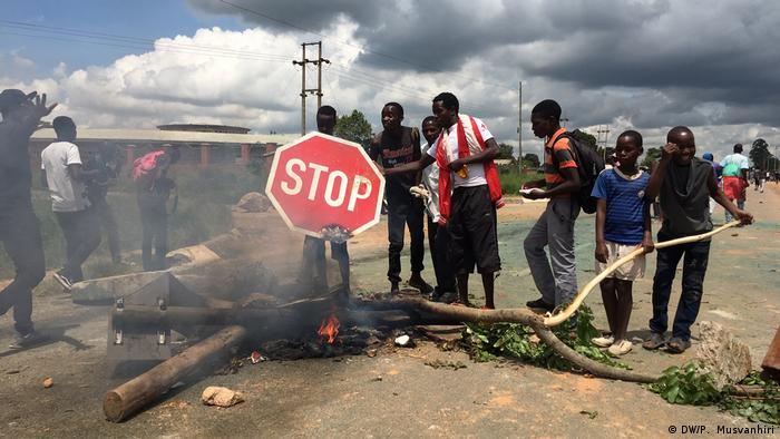 Protesters gather in the low-income suburb of Epworth in Zimbabwe's capital Harare