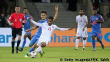 India's forward Sunil Chhetri (L) fights for the ball with Bahrain's midfielder Ali Madan during the 2019 AFC Asian Cup group A football match between India and Bahrain at the Sharjah Stadium in Sharjah on January 14, 2019. (Photo by Karim Sahib / AFP) (Photo credit should read KARIM SAHIB/AFP/Getty Images)