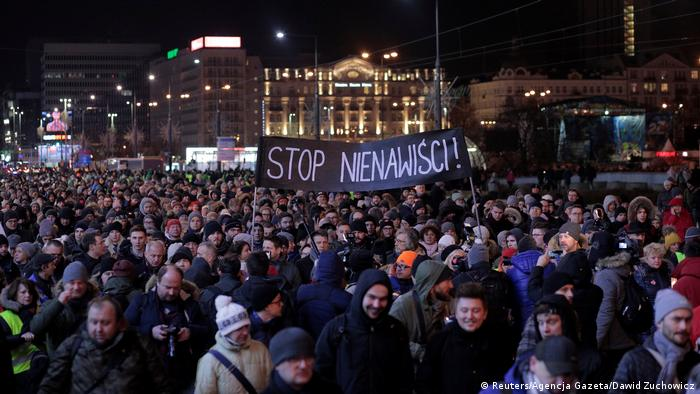 People gathered at a vigil for Gdansk Mayor Pawel Adamowicz