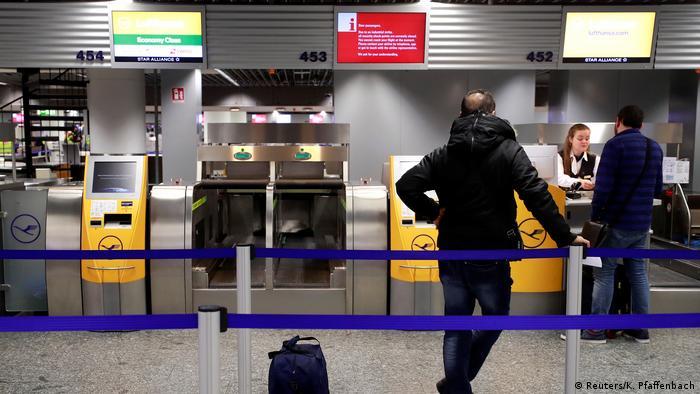 Passengers wait to speak to airline representatives at Frankfurt International Airport (Reuters/K. Pfaffenbach)