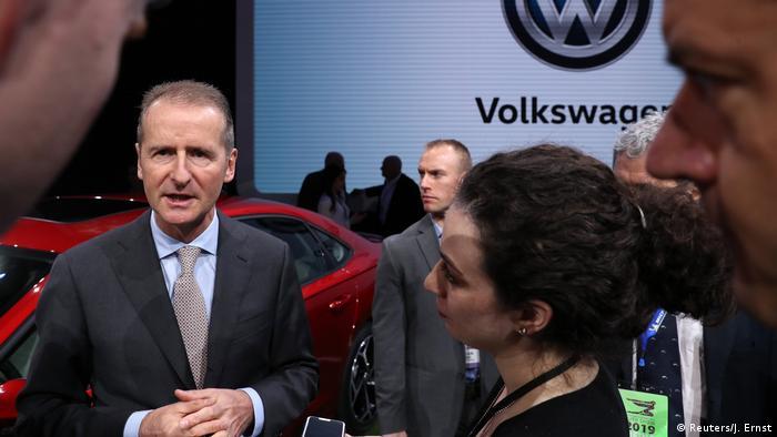 Volkswagen CEO Herbert Diess speaking to the media in Detroit