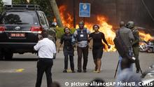 Security forces help civilians flee the scene as cars burn behind, at a hotel complex in Nairobi, Kenya Tuesday, Jan. 15, 2019. Extremists have launched an attack on a luxury hotel in Kenya's capital, sending people fleeing in panic as explosions and heavy gunfire reverberate through the neighborhood. A police officer says he saw bodies, but there was no time to count the dead. Al-Shabab _ the Somalia-based extremist group _ is claiming responsibility. (AP Photo/Ben Curtis) |
