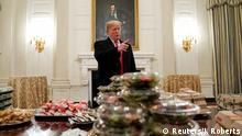 14.01.2019 +++ U.S. President Donald Trump speaks in front of fast food provided for the 2018 College Football Playoff National Champion Clemson Tigers due to the partial government shutdown in the State Dining Room of the White House in Washington, U.S., January 14, 2019. REUTERS/Joshua Roberts TPX IMAGES OF THE DAY