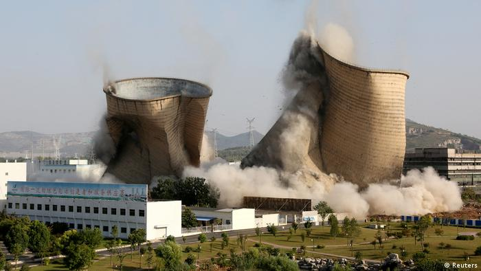 Power plant chimneys being demolished in China