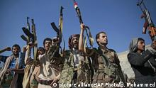 FILE - In this Dec. 13, 2018, file, photo, tribesmen loyal to Houthi rebels hold up their weapons as they attend a gathering to show their support for the ongoing peace talks being held in Sweden, in Sanaa, Yemen. The United Nations has cast doubt on the claims by Yemen's Shiite rebels to have withdrawn from the port of Hodeida, saying such steps can only be credible if all other parties can verify them.(AP Photo/Hani Mohammed, File) |