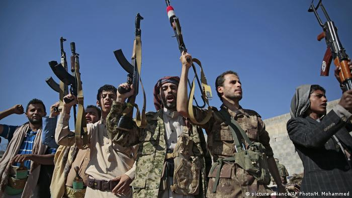 In this Dec. 13, 2018, file, photo, tribesmen loyal to Houthi rebels hold up their weapons as they attend a gathering to show their support for the ongoing peace talks being held in Sweden