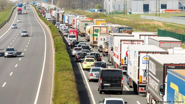 Hundreds of trucks stand in a traffic jam in western Germany