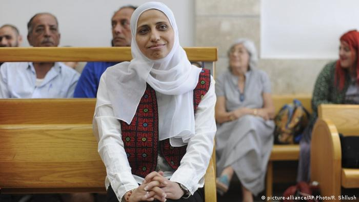 Dareen Tatour, a Palestinian social media activist in a courtroom