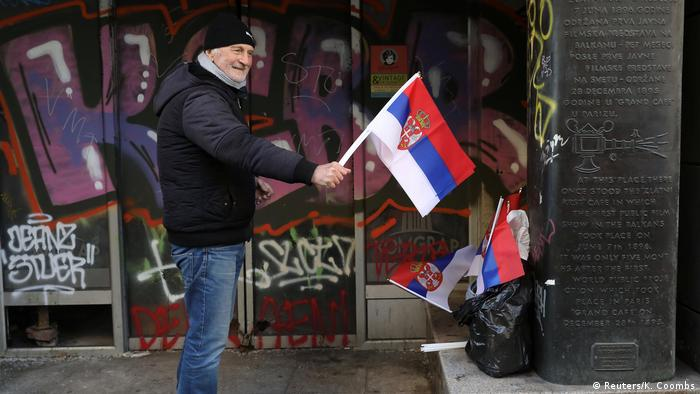 A man holding a Serbian flag during Putin's visit to Belgrade in January 2019 (Reuters/K. Coombs)