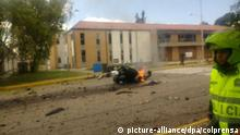 The burning remains of a car bomb at Bogota's General Santander Police Academy (picture-alliance/dpa/colprensa)