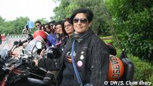 Indian women from the female motorcycling club Bikerni standing next to their bikes.