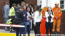 Family members of victims of a bombing gather outside the entrance to the General Santander police academy where the bombing took place in Bogota, Colombia, Thursday, Jan. 17, 2019. (AP Photo/John Wilson Vizcaino) |