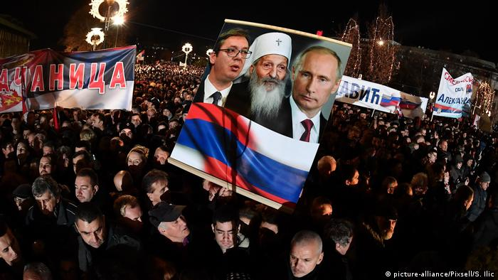 People gather in front of the Serbian Orthodox Temple of St. Sava with the goal of welcoming Russian President Vladimir Putin