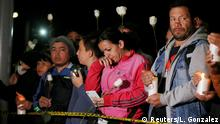 People take part in a candlelight vigil to honor victims, close to the scene of a car bomb explosion, in Bogota, Colombia January 17, 2019. REUTERS/Luisa Gonzalez
