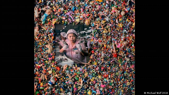 square of plastic toys with picture of a worker in the middle (Michael Wolf 2018)