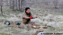 Hoshyar Ali, who lost both legs in a landmine explosion, holds mines while trying to deactivate them on the outskirts of the Kurdish town of Halabja, Iraq January 4, 2019. Picture taken January 4, 2019. REUTERS/Ako Rasheed