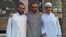 Ali Adubisi (center) with two friends after his release from prison in Saudi Arabia