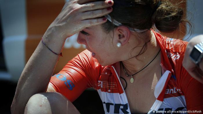 Italian cyclist Letizia Paternoster wipes away sweat during the Santos Tour Down Under 2019