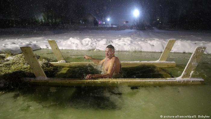 Orthodox Russians jump into icy waters to celebrate Epiphany