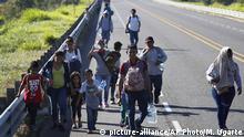 Migranten überqueren illegal die Grenze zwischen Guatemala und Mexiko