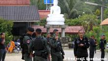 Thai military police stand in front of temple (Reuters/S. Boonthanom)