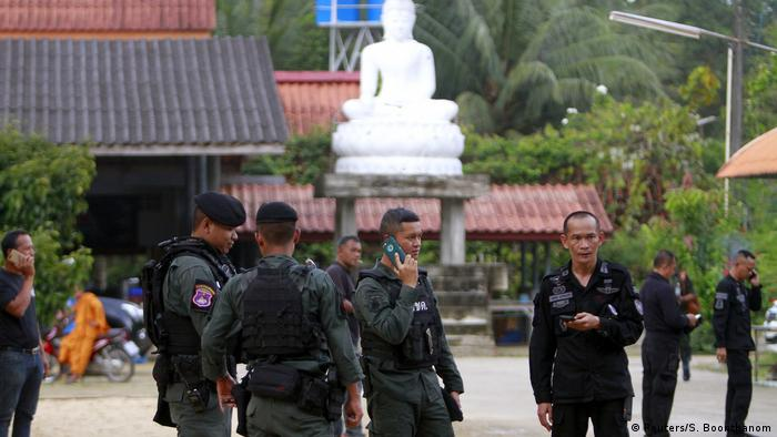 Thai military police stand in front of temple